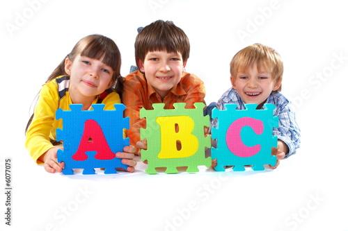 Children with Alphabet Puzzle #6077075
