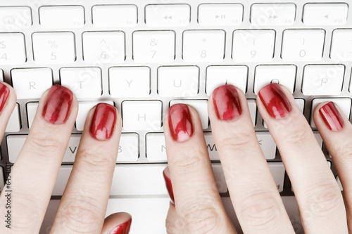 Canvas Print Fingers with red nail