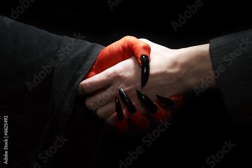 Valokuva Handshake with Devil
