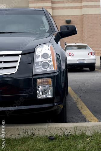 Fotografia Black Cadillac's front bumper and headlight