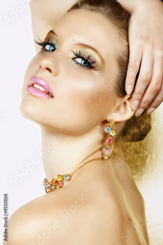 Beautiful blond woman with long lashes and colourful stones #9533836