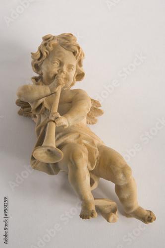 Carved wooden Xmas tree ornament:  cherub playing horn Fototapeta