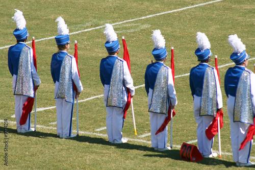 Obraz na plátně Flag Corp. of a band preforming a half time show.