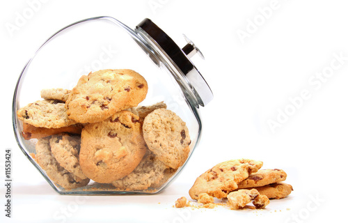 Glass  jar with cookies against a white Fototapet