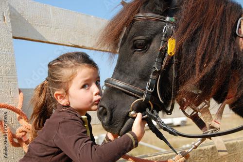 Fotografija l'enfant et son poney