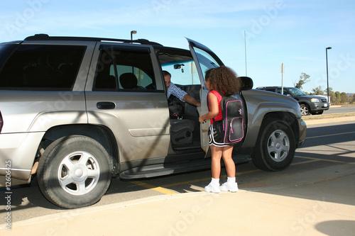 Fotografia Girl after school ride home.