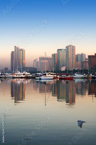 calm waters of manila bay at dawn
