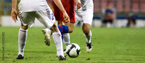Fotografia Soccer players fighting for the ball