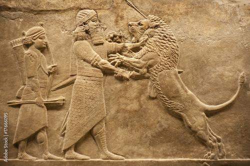 Obraz na plátně Assirian warrior hunting lions