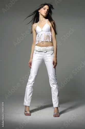 Fotografie, Tablou Beautiful girl posing in studio isolated