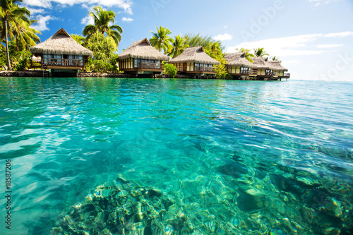 Over water bungalows with steps into green lagoon #18587206