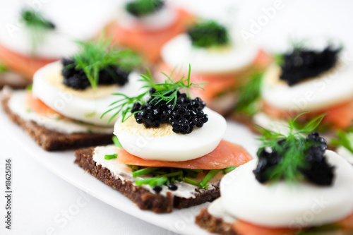 Canvas Print Canapes with smoked salmon and caviar