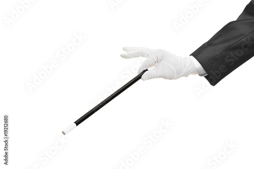 Hand holding a magic wand isolated on white background