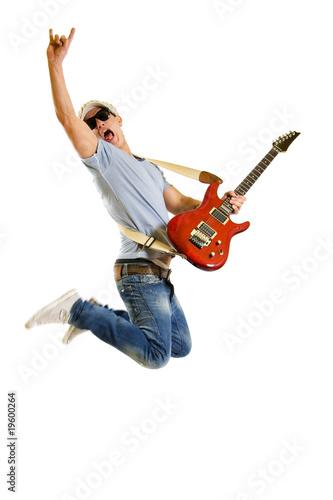 Obraz na plátně Passionate guitarist jumps isolated on white