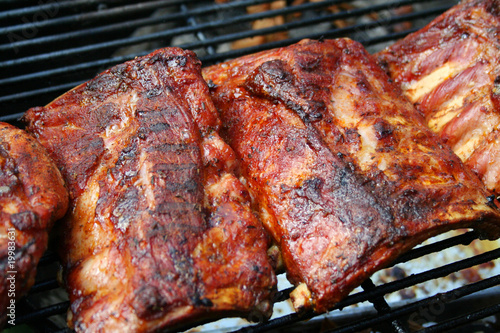 Wallpaper Mural Barbecue pork ribs on a grill