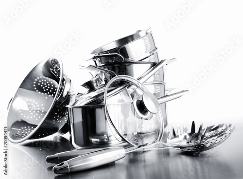 Pile of pots and pans against  white