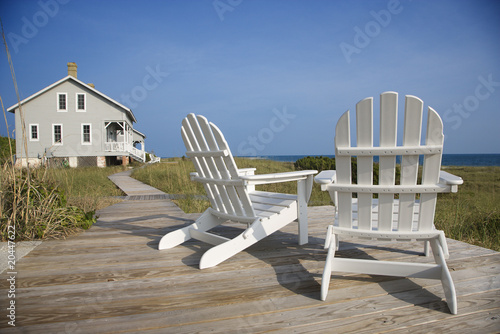 Photo Chairs on Deck Facing Ocean