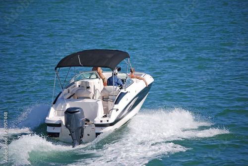 Fotografia Outboard Motorboat with Blue Canvas Canopy
