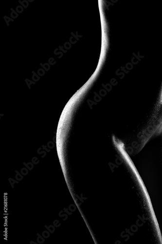 Fototapeta Kobieca sylwetka na czarnym tle na zamówienie