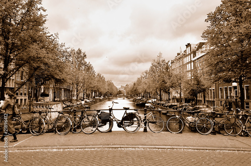 View of the Amsterdam center with bicycles on a bridge #21896412
