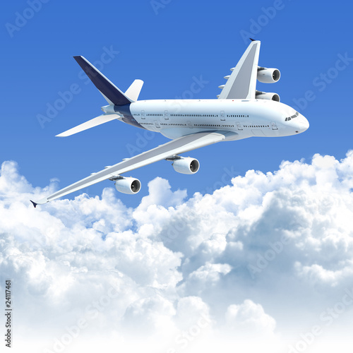 Wallpaper Mural airplane flying over the clouds
