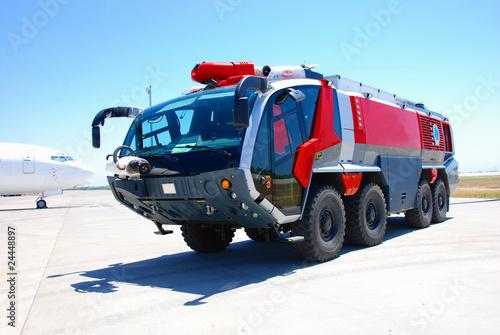 Valokuvatapetti Red fire engine at airport