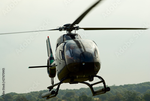 Canvas Print Closeup of the landing EC-120 Colibri helicopter