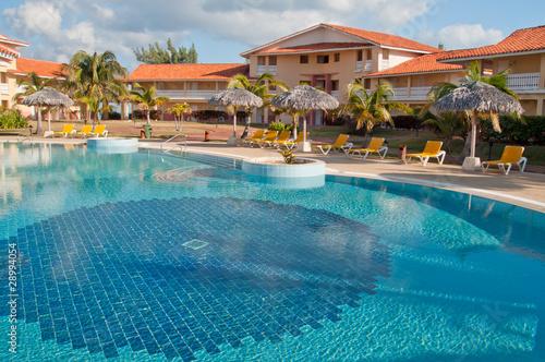 Fototapeta Swimming pool in tropical resort