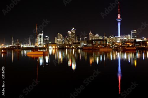 Auckland City night lights reflect on harbor