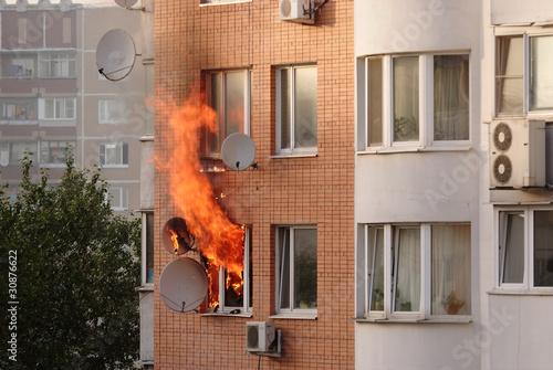 Fotografija fire in the window of building