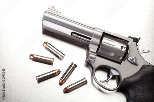 gun with bullets on steel - modern revolver handgun Fototapeta