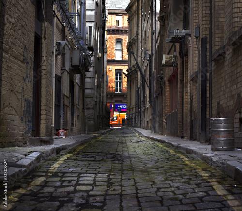 Fényképezés Looking down a long dark back alley