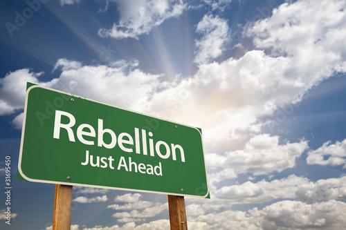 Obraz na plátně Rebellion Green Road Sign and Clouds