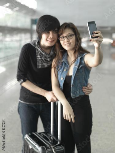 Obraz na plátně Asian Chinese couple taking self portraits
