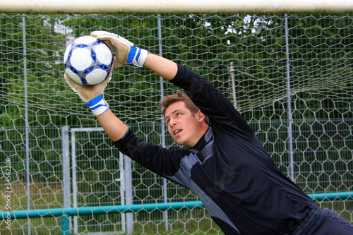 Leinwand Poster Tormann hält den Ball