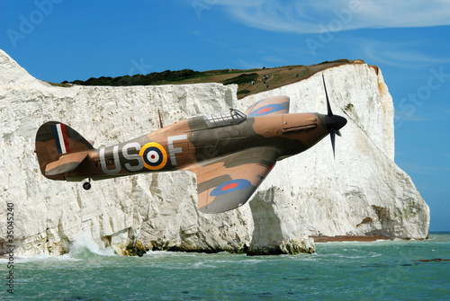 Canvas Print Spitfire over the white cliffs of Dover