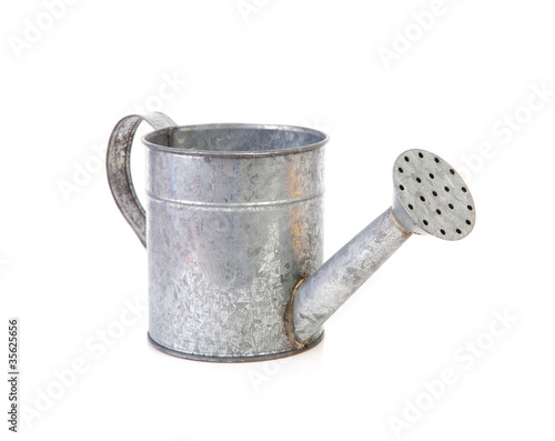 Fototapeta iron watering can over white background