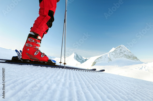 Canvas Print skier on an untouched ski track