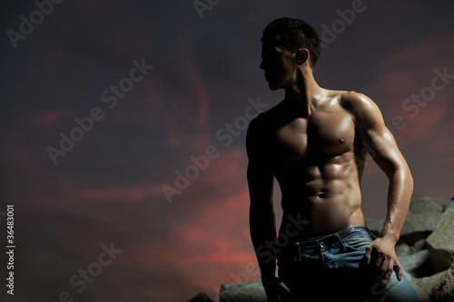 Wallpaper Mural Muscular body of an handsome bodybuilder