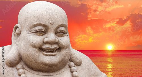 Fotografia Buddha and a sunset