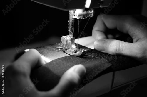 Obraz na plátne Hands of Seamstress Using Sewing Machine