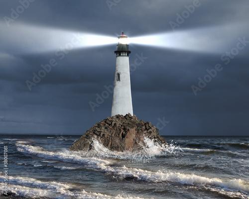 Obraz na płótnie Lighthouse with a beam of light