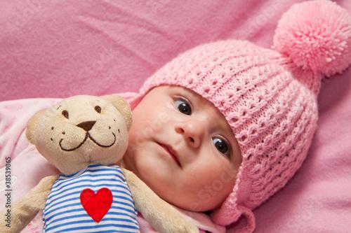 Obraz na plátne Little girl  with her teddy bear