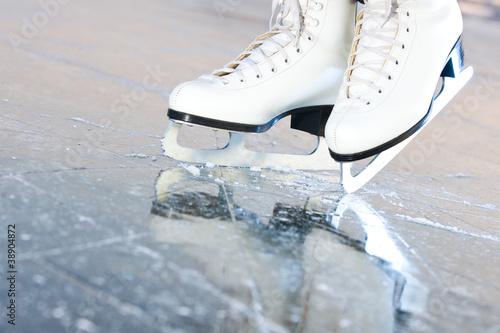 Fototapeta Tilted natural version, ice skates with reflection