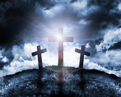 Fototapeta Silhouette of three crosses on a hill