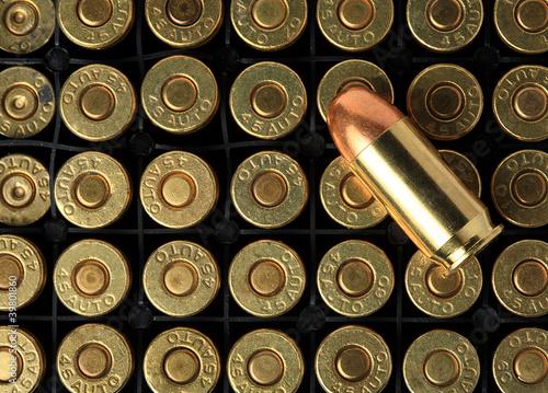 pistol ammo in box isolated. Fototapete