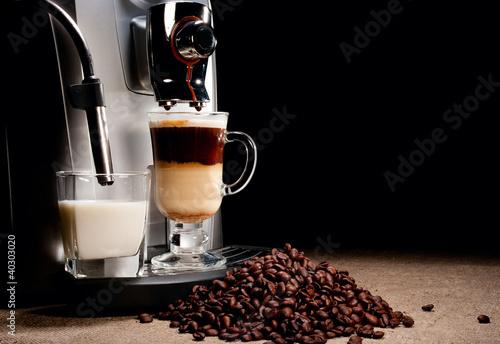 Fotografija Coffee machine and beans heap