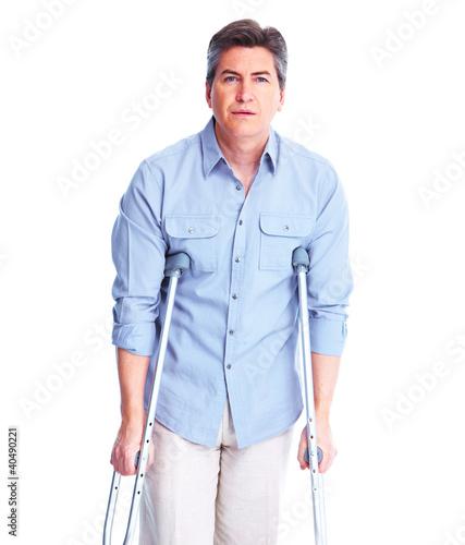 Fényképezés Man with crutch.