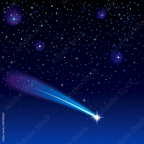 Shooting star going across a starry sky.