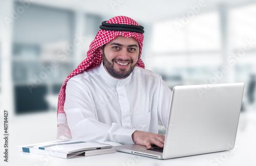 Tablou Canvas arabian businessman using laptop in his office